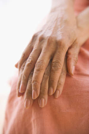 searcher: Close up of senior woman's hands on knee