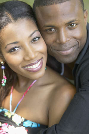 adoring: Portrait of African couple hugging