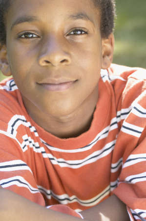 jamaican ethnicity: Close up of African boy smiling LANG_EVOIMAGES