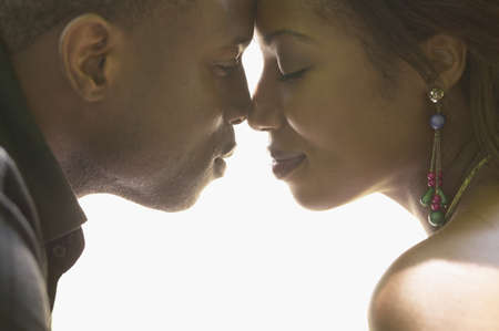 african american nude: African couple touching noses LANG_EVOIMAGES