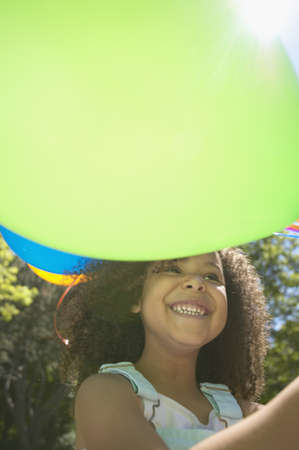jamaican ethnicity: Close up of African girl holding balloons