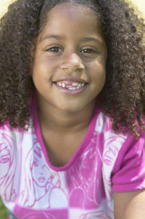 lighthearted: Close up of African girl smiling