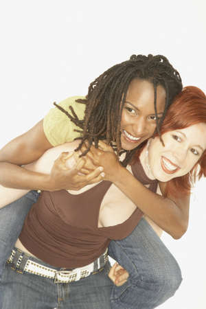 black lesbian: Studio shot of female couple playing