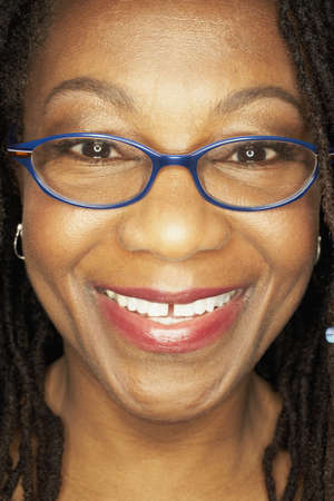 middleaged: Close up of middle-aged African woman wearing eyeglasses