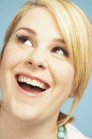 idealistic: Close up of young woman looking up