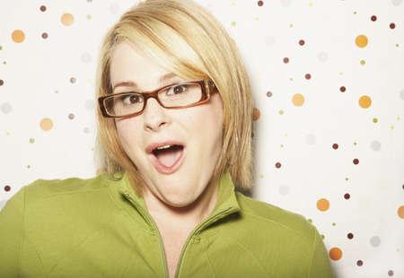 exerting: Surprised young woman wearing eyeglasses LANG_EVOIMAGES
