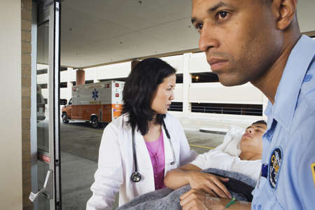 wheeling: Paramedic and doctor wheeling man on gurney