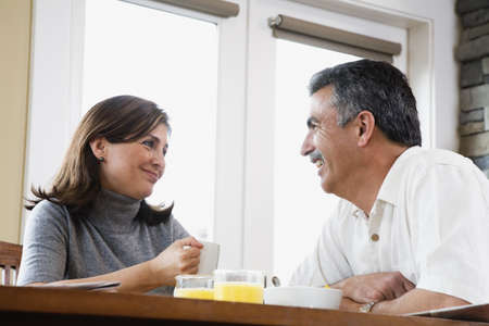 woman middle age: Middle-aged couple eating breakfast