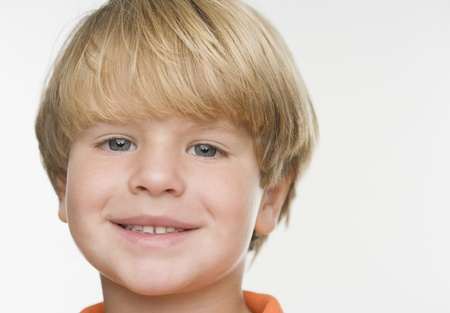 motioning: Close up of young boy smiling LANG_EVOIMAGES