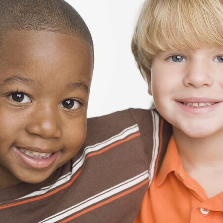 Close up of two young boys smiling