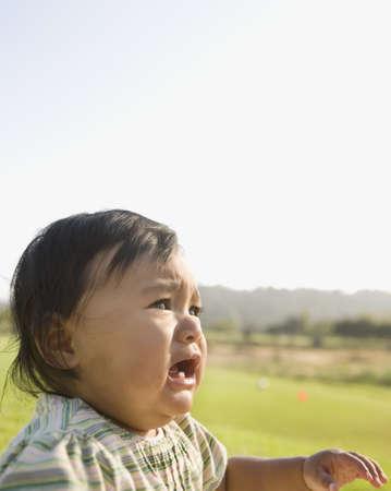 bambino: Asian baby crying outdoors