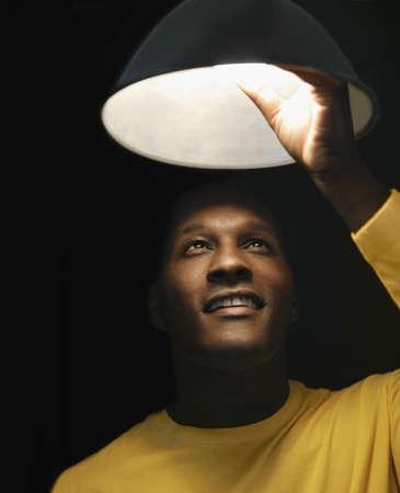grampa: African man changing light bulb LANG_EVOIMAGES