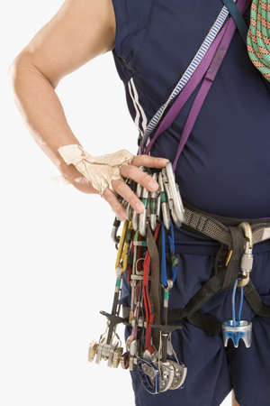 endangering: Man wearing rock climbing gear