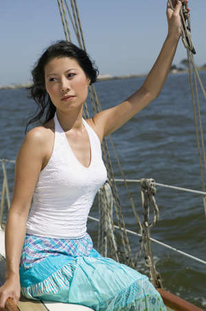 immense: Portrait of Asian woman on sailboat