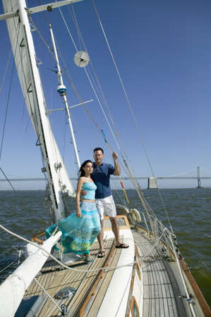 adventuresome: Portrait of couple on sailboat