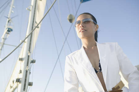 male bonding: Portrait of Asian woman on sailboat