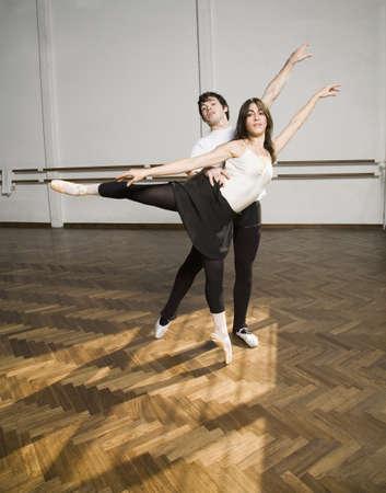 wearying: Hispanic dancers practicing in dance studio LANG_EVOIMAGES