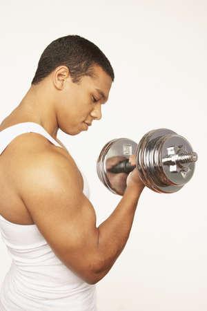 mischeif: Portrait of African man lifting weights