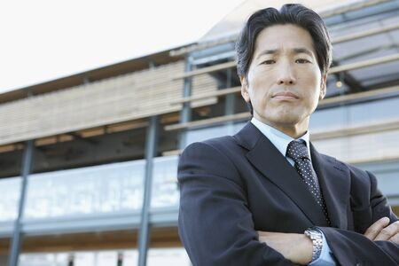 1 person: Portrait of Asian businessman with arms crossed