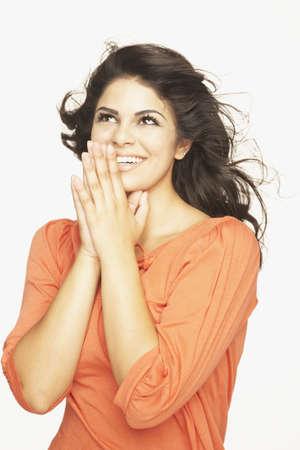 motioning: Portrait of happy Hispanic woman