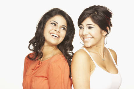 motioning: Portrait of Hispanic adult sisters