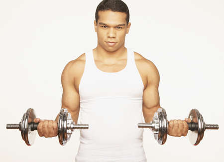 poppa: Portrait of African man lifting weights