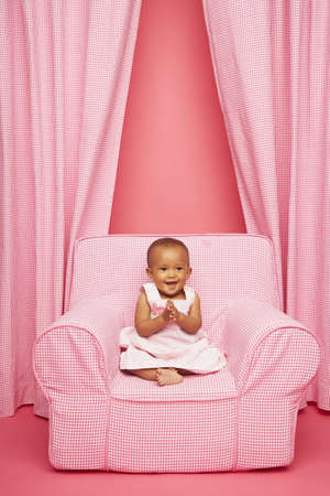 stepping: Baby clapping on chair