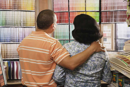 giver: Couple looking at paint swatches in store