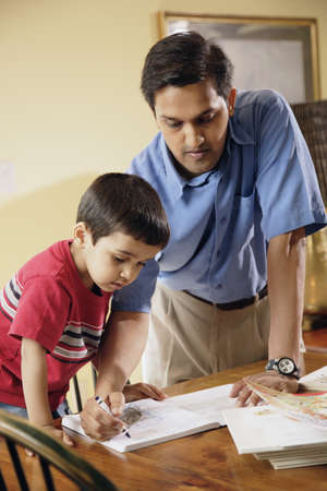 gramma: Indian father helping son with homework