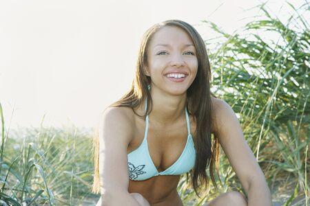 bathingsuit: Portrait of African woman in bikini