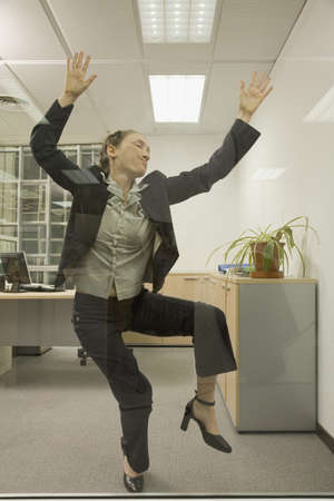 pushed: Hispanic businesswoman pushed up against glass wall LANG_EVOIMAGES