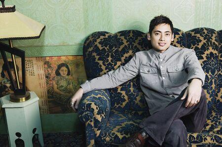 davenport: Portrait of Pacific Islander man on sofa