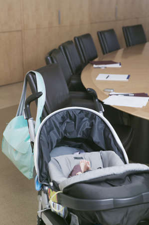 alehouse: Baby in stroller next to conference table LANG_EVOIMAGES