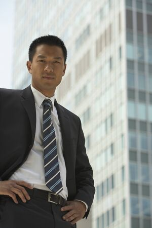 sky scraper: Portrait of Asian businessman in front of sky scraper