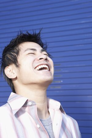 casualness: Close up of Pacific Islander man laughing