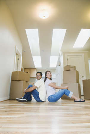 casualness: Portrait of Asian couple in new house
