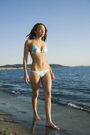 bathingsuit: African woman walking on beach