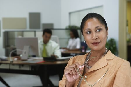 african american woman business: Portrait of African businesswoman looking sideways LANG_EVOIMAGES
