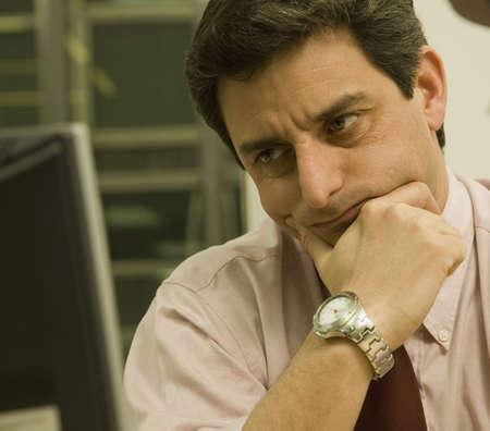 saturating: Hispanic businessman looking at computer