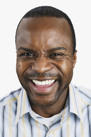 wearying: Close up of African man laughing