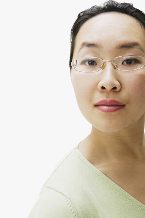mischievious: Portrait of Asian woman wearing eyeglasses