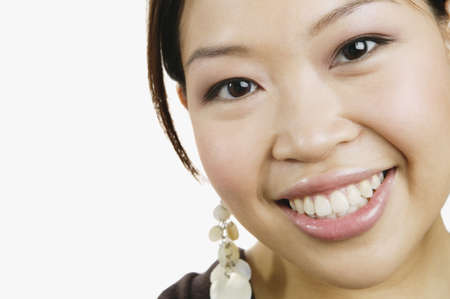 spectating: Close up of Asian woman smiling
