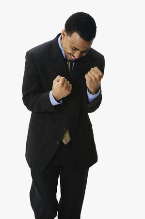 relishing: Portrait of African businessman cheering