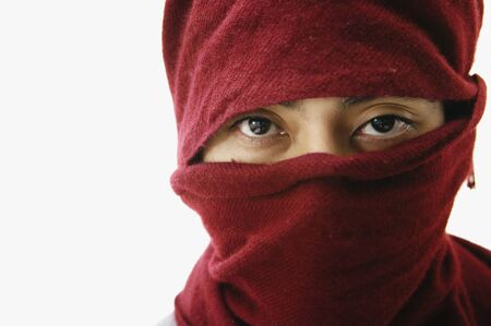 islander: Pacific Islander man with scarf covering head and face