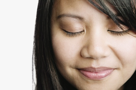 eye's closed: Asian woman smiling with eyes closed