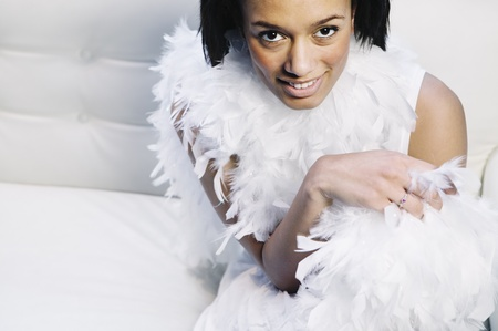 feather boa: African woman wearing feather boa LANG_EVOIMAGES