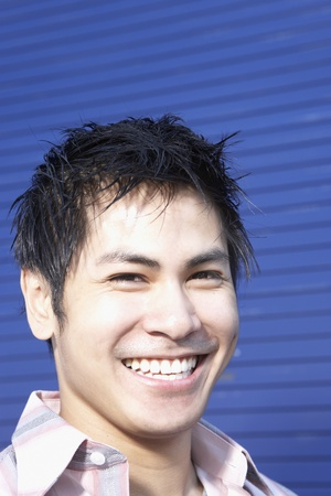 pacific islander ethnicity: Close up of Pacific Islander man smiling LANG_EVOIMAGES