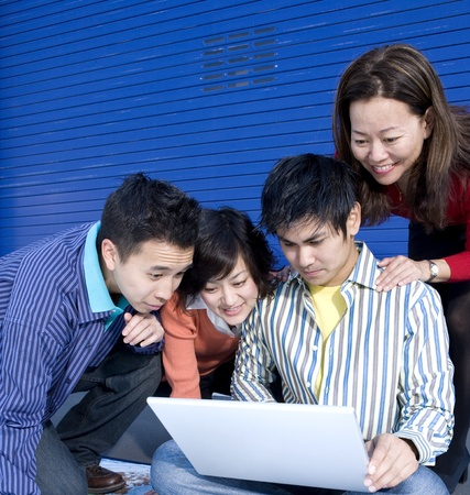 Group of young businesspeople looking at laptop