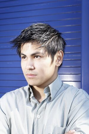 pacific islander ethnicity: Close up of Asian man looking serious