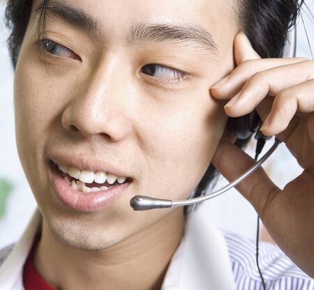 Close up of Asian businessman wearing headset